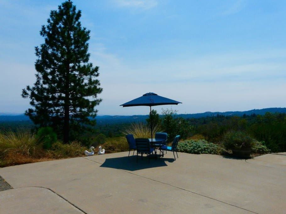 View of the dining table with a portion of the 180 degree view of the Sierra Foothills.