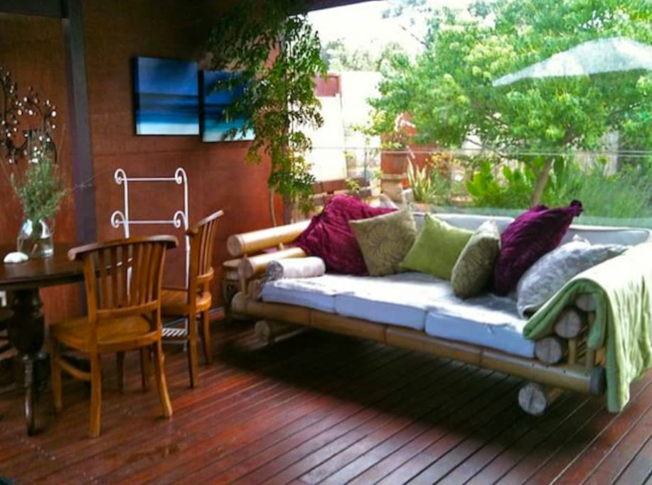 Eat, drink and relax in the covered spa area