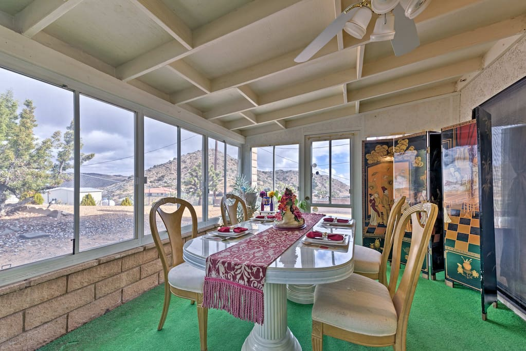 Gaze out at the scenic mountain views from the screened porch.