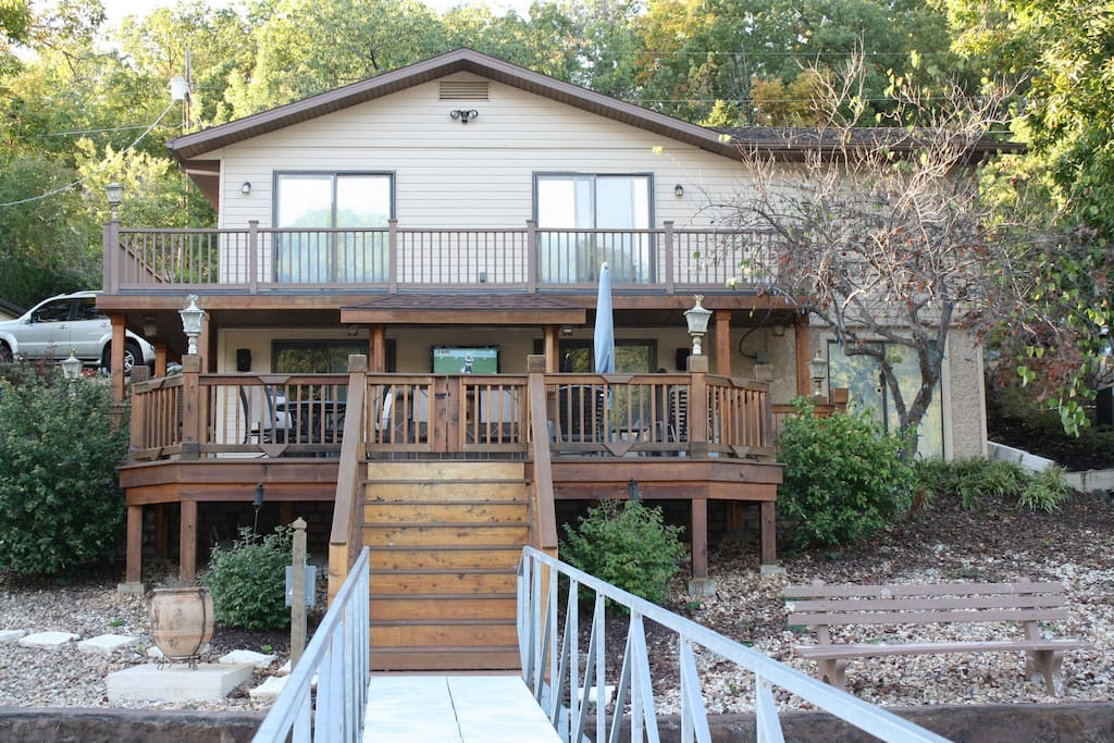 Lakeside view of our vacation home.   Great all cedar deck w easy access to dock.  Wow ... talk about access!