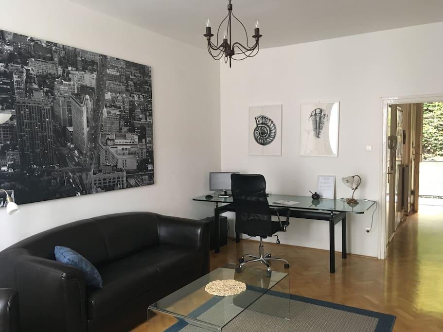 Livingroom with sofa and glass desk