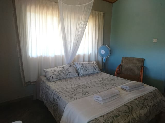 Sunrise Bedroom 2 with double bed + single bed.  Can sleep 3 guests
