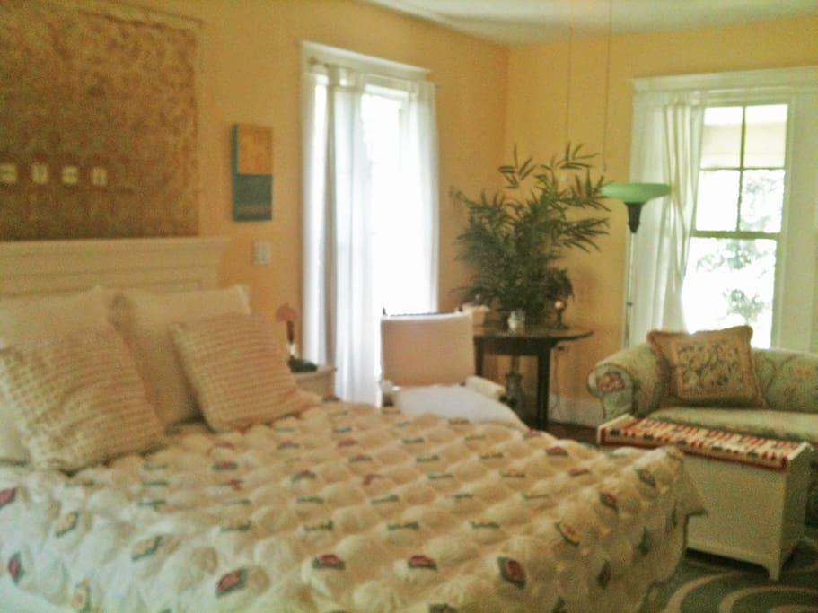 Queen bed with desk and seating.