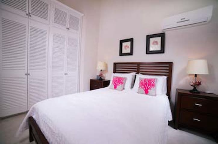 Bedroom 2 has its own mini balcony looking south.  It is air conditioned and has a double queen size bed and ample closet space.