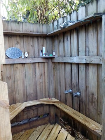 Outdoor shower has hot water and is private.  There are two showers available.