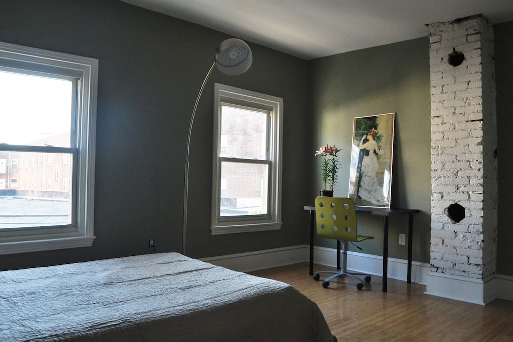 Private bedroom with full sized bed, desk & closet