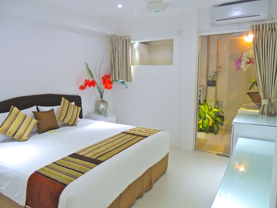 BED 2 King size room, magnificent King Koil mattresses and Icy cold clean air-conditioning. Semi out door ensuite.