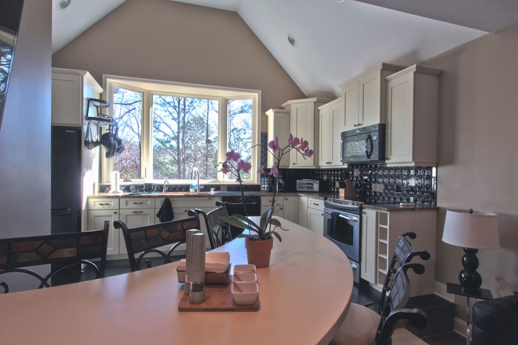 full kitchen with views and counter
