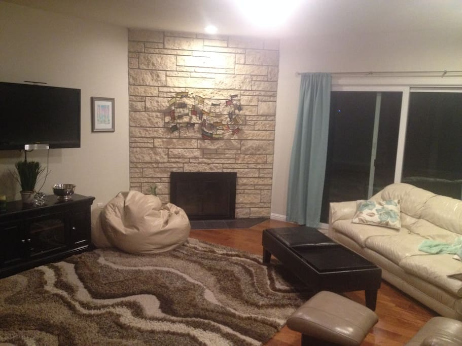 Main living room with cable tv- sliding glass door to patio