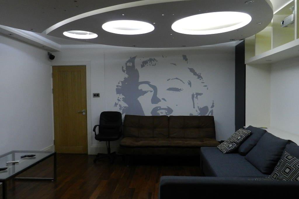 Lounge with fabulous lighting platform and mural