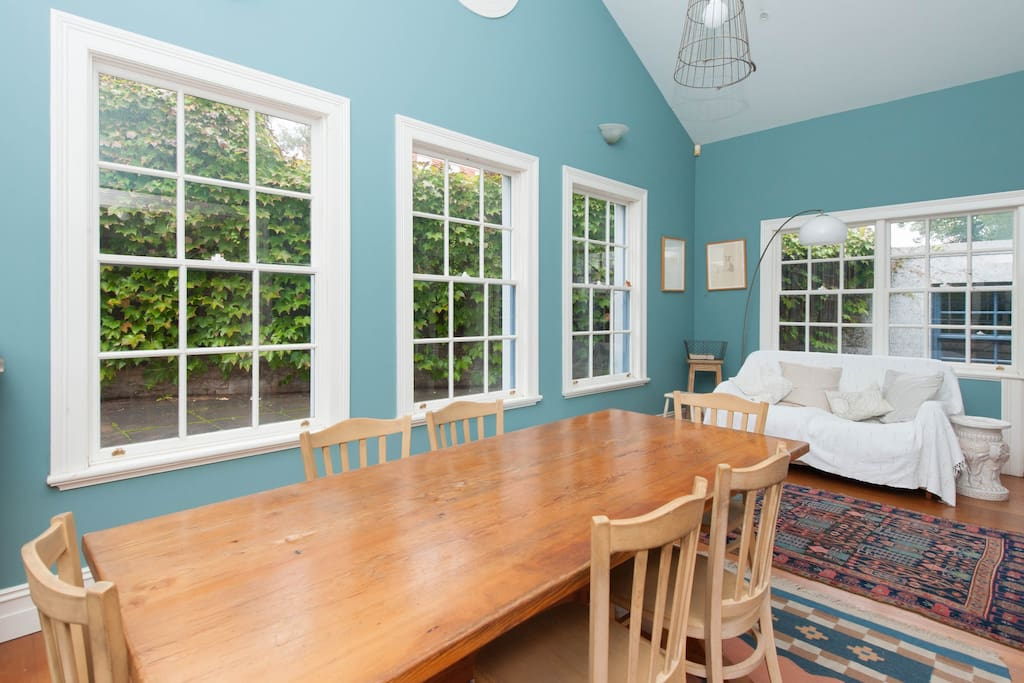 Ground floor dining room with hardwood floors and French windows.