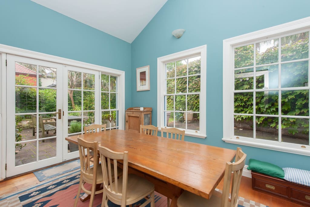 Ground floor dining room with hardwood floors and French windows with access to landscaped courtyard.