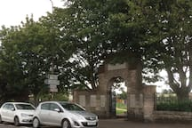The bus stop to get off when arriving is just after this archway at Loanhead Memorial Park