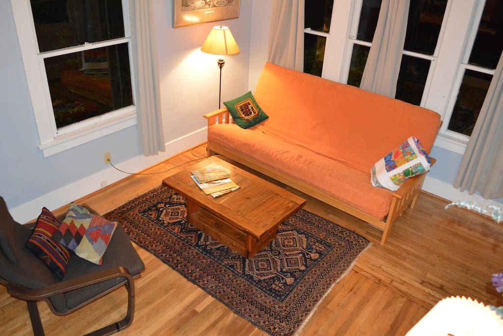 5 - The front room with a queen size futon to that can be folded out for sleeping.