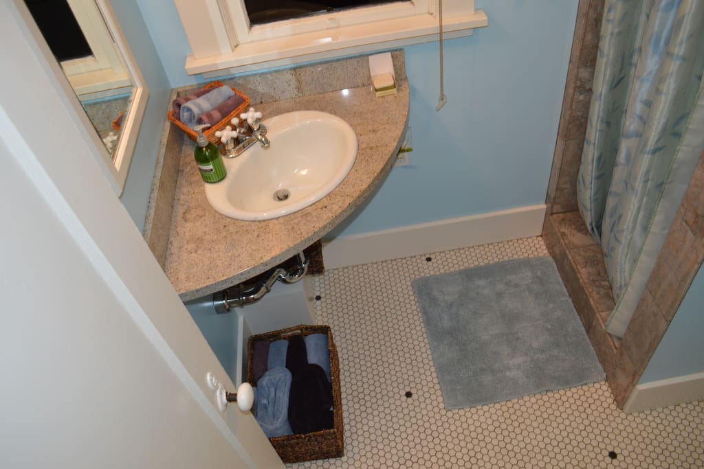 2 - Traditionally styled tile and marble bathroom.