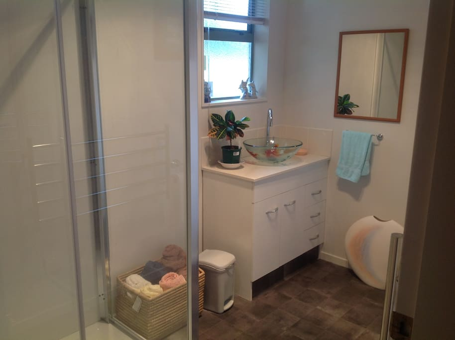 The bathroom has a large shower and a heated towel rail for your comfort