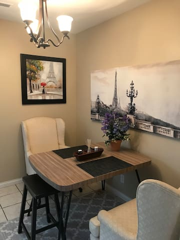 Dinning room area, Paris theme! enjoy the beautiful artwork located on the walls. The most relaxing dinning room chairs ever, to enjoy your meal.