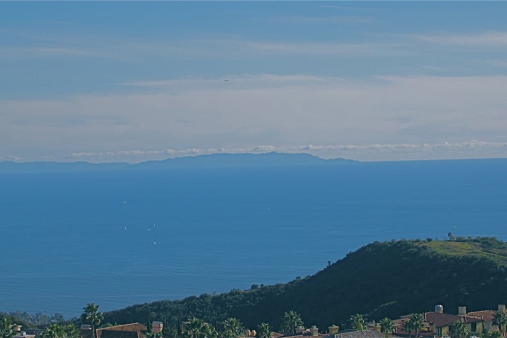 Backyard view of Catalina Island, Palos Verdes Peninsula & Channel Islands with sailboats on the Pacific ocean