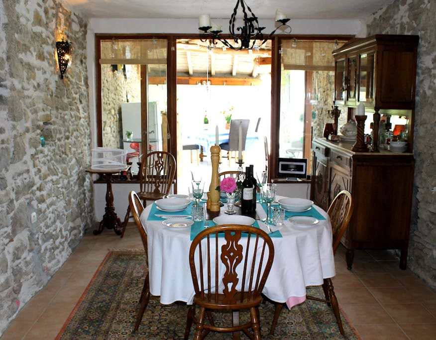 Old stone walls of the dining room leading to the porch and roof terrace