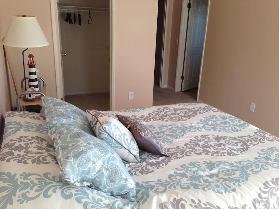 The room is very spacious with high ceilings and a queen size bed.
