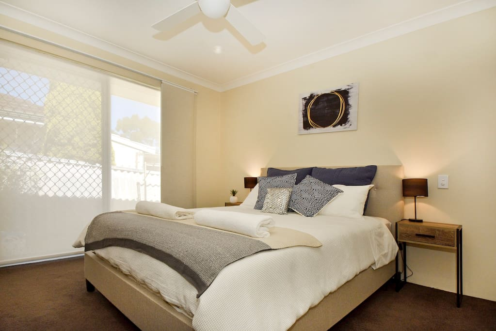 Spacisous master bedroom with comfortable queen bed. Walk in Robe and outlook to the sunny yard