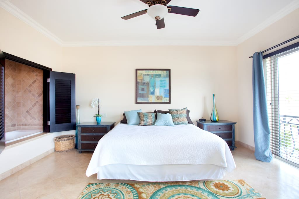 Master suite---the sliding doors shown faces the pool, the bed faces another sliding door which has views of the beach and walks out to the balcony.