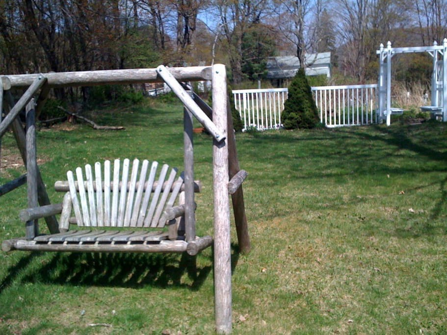 The Romantic Wooden Swing in  the back yard