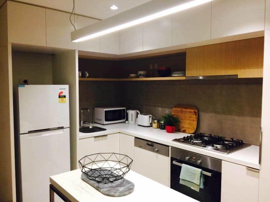 Brand new fridge, microwave and toaster in kitchen. Stunning modern kitchen with gas cooktops and oven.