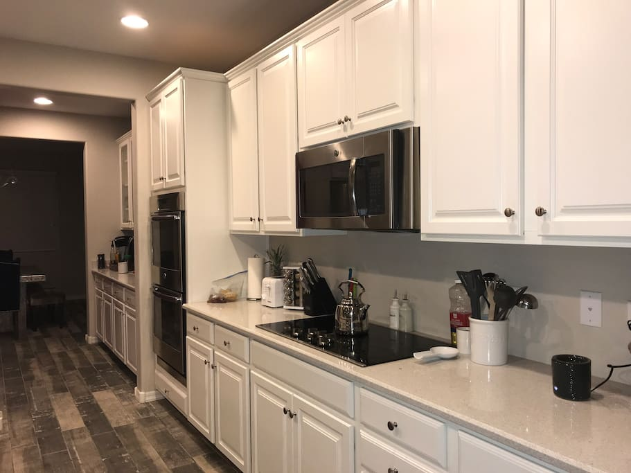 Large Kitchen with double ovens, butlers pantry, leading to formal dining room