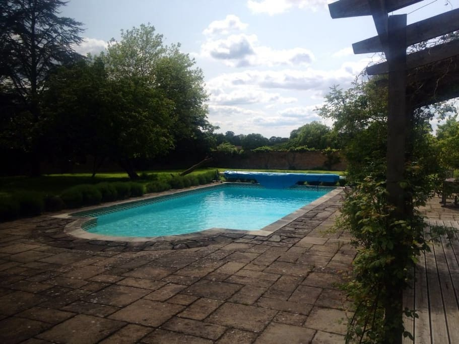 Swimming pool west facing with barbecue next to lawns for badminton and football
