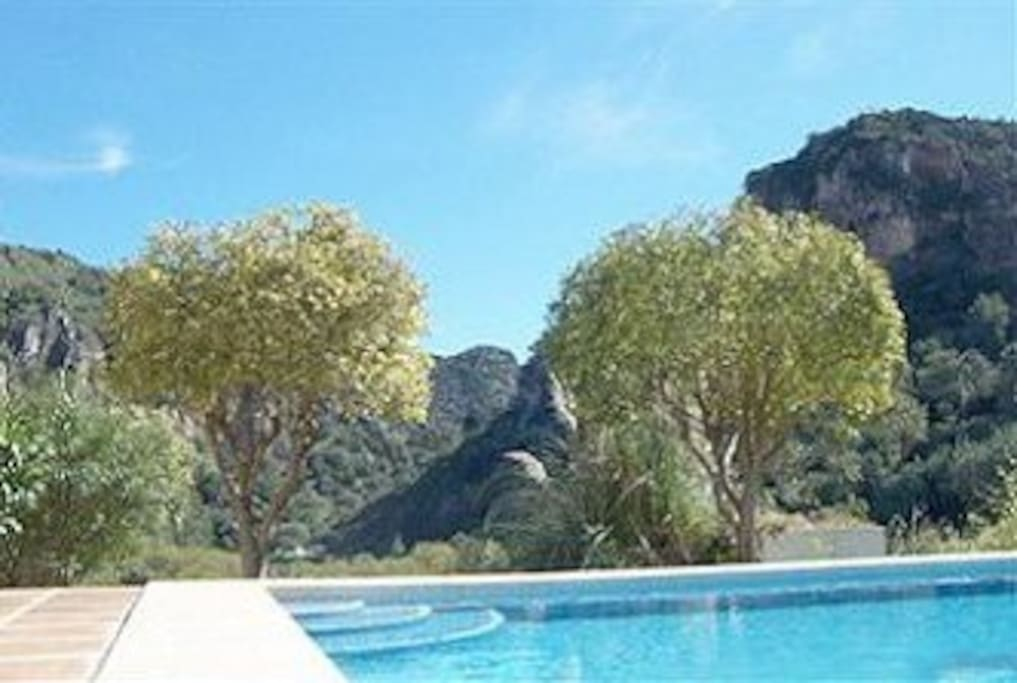 Private outdoor heated swimming pool with uninterrupted mountain views