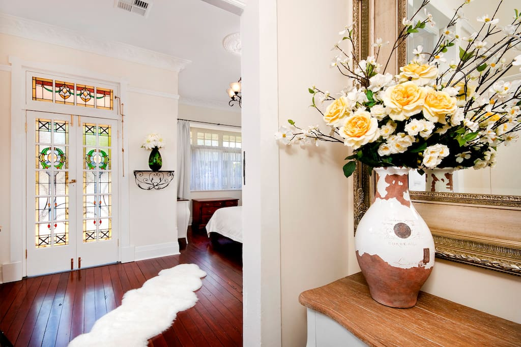 Hall table and large mirrors enhance the space entry foyer.