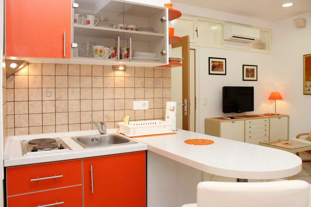 Kitchen with Refrigerator, Dish sink, Stove, Microwave, kettle...