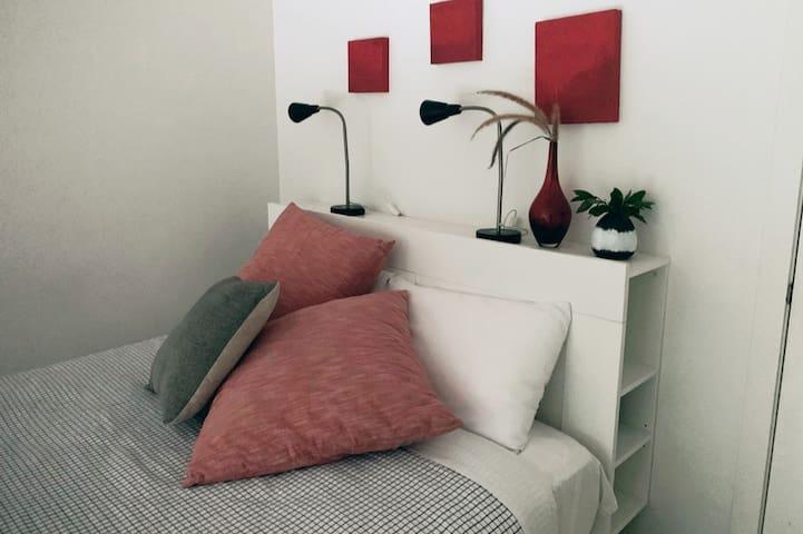 Beautiful Queen bed with luxury linen