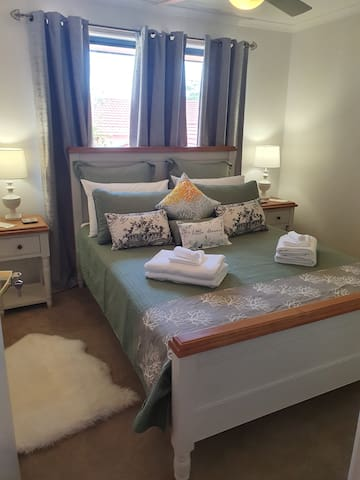 Queen Room with built in w/robe and Fan