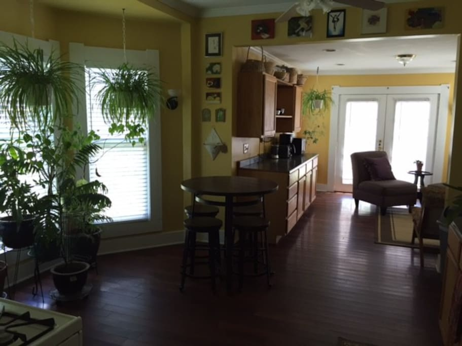 Kitchen is fully equipped with appliances, dishes etc, microwave, coffee pot, and sitting area.