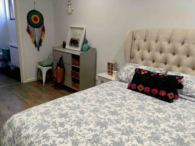 Large main bedroom with new double bed, house and garden linen, princess bedhead. Chest of drawers and mirrored built in robe welcome to use. En-suite off bedroom.