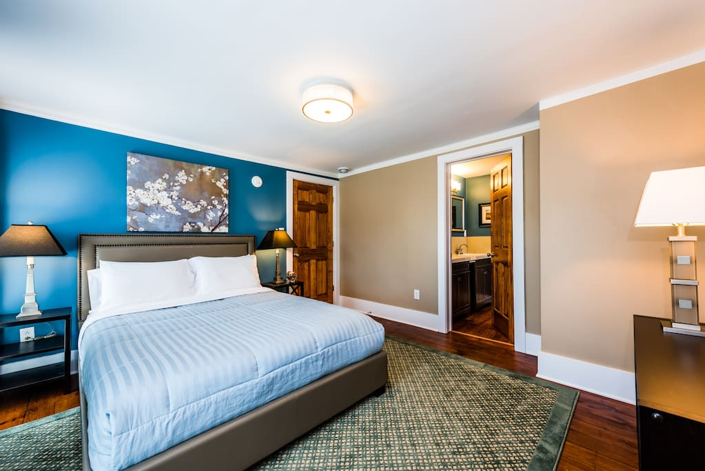 Room 4 - 2nd Floor: two-room suite that sleeps 1-4 guests and features a queen luxury plush mattress set, quality linens, central air-conditioning, WiFi, closet/storage, bedside lamps, dressing mirror and fully equipped private ensuite (dual vanity) bathroom.