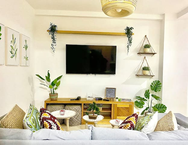 """Cozy, Boho living room with Comfortable Sofa, 55"""" Smart TV with Netflix ready, Hundreds of Channels, Movies, Super Fast WIFI and much more."""