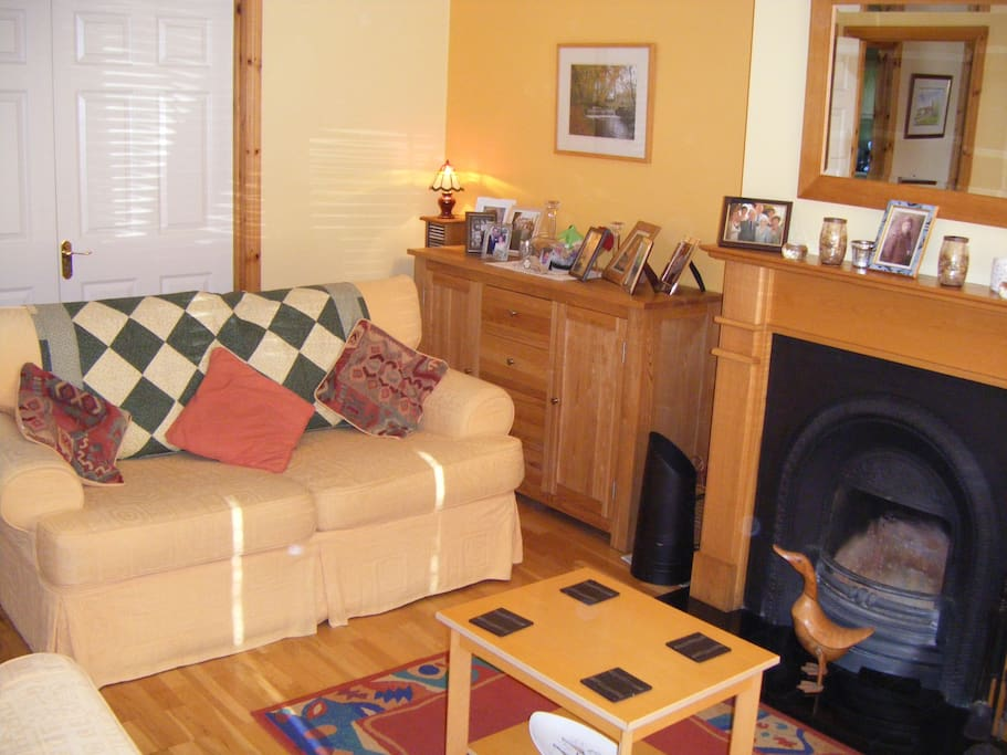 Living room with double doors leading to dining area.