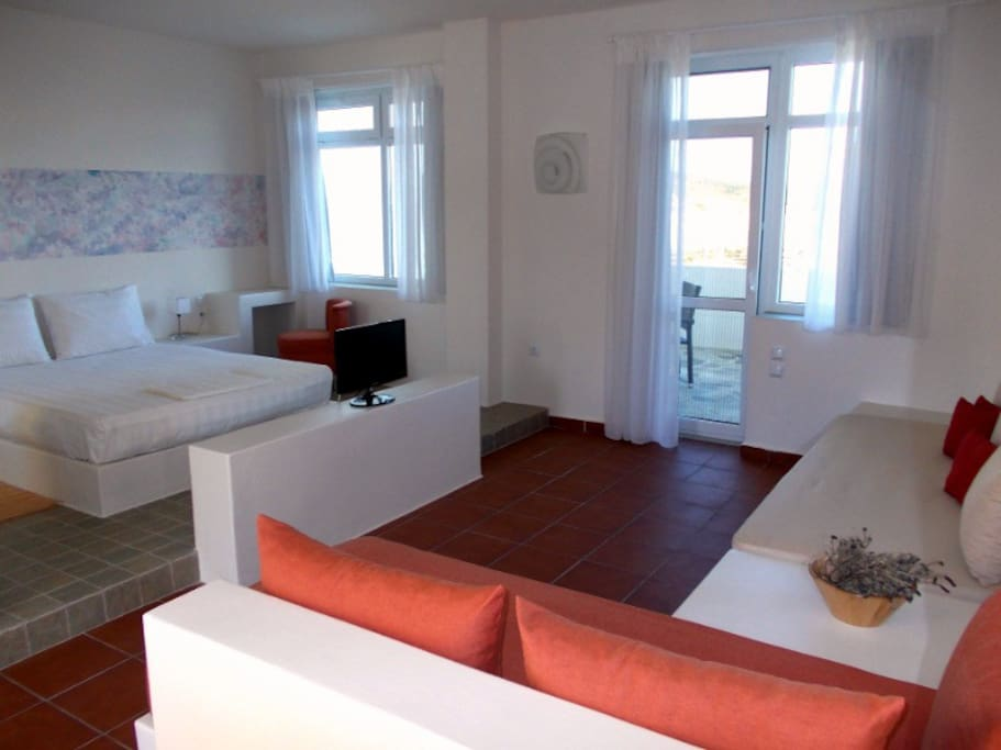The bedroom of the stylish open plan studio