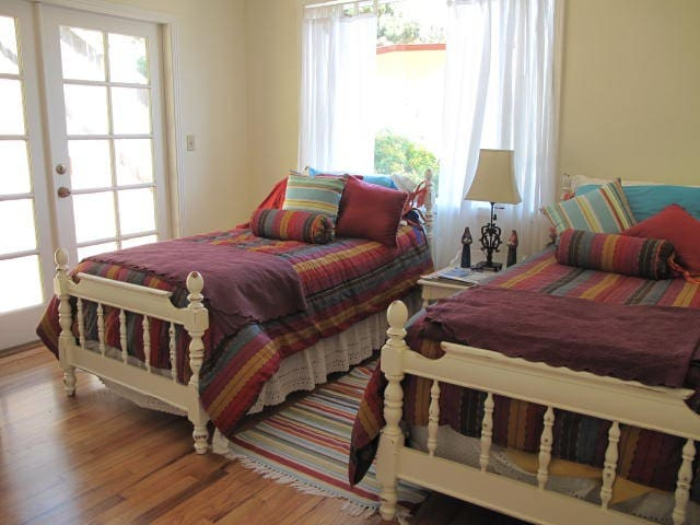 Twin beds in Back Bedroom. French Doors to Beautiful back garden.