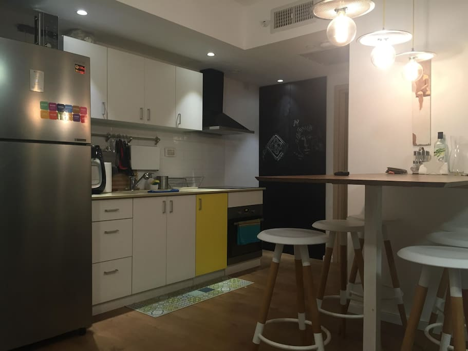 The kitchen and the refrigerator, filtered water bar, at the dining table