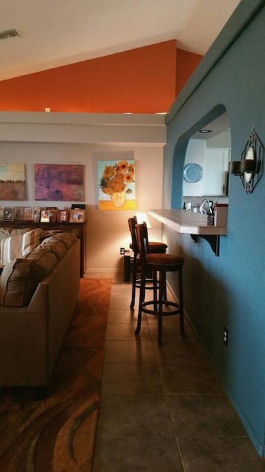 Convenient eating bar with 2 stools in the middle of family room and kitchen.