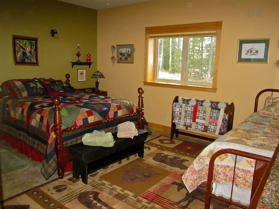 Master Bedroom has a queen bed and a twin bed.