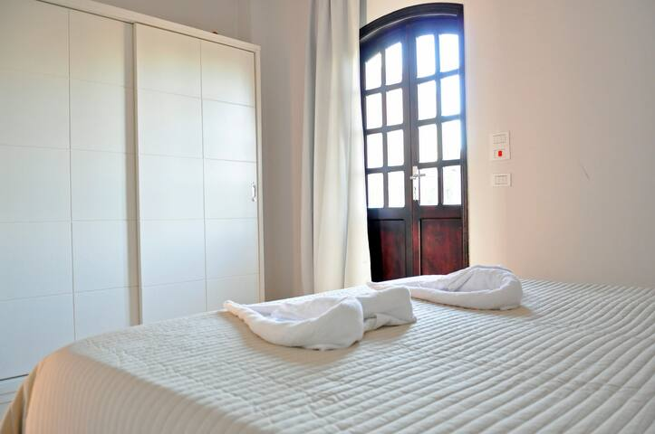 Bedroom with large wardrobe and doors to the 2nd balcony