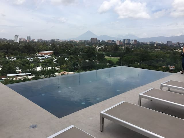 Infinity pool with views to the volcanoes