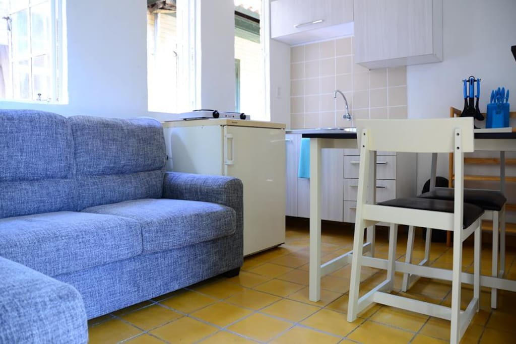 The kitchen / living room includes a refrigerator, microwave, electrical cooking, a full set of pots & pans, utensils, plates, cups etc. There is free high speed WIFI throughout the apartment. The table includes two chairs and shelves.