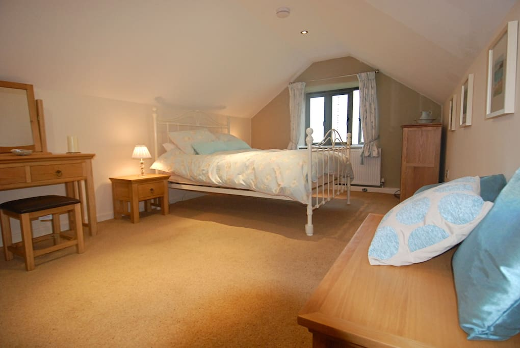Romantic bedroom in the eaves with beautiful views across the valley