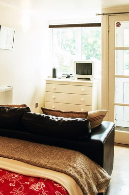 Double bedroom with sofa, TV/DVD player